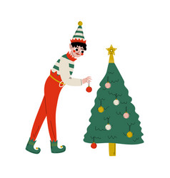 christmas elf character decorating tree vector image