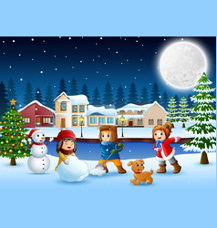 Happy kids making a snowman in the snowy village vector