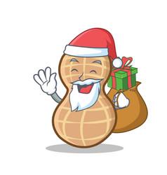 Santa with gift peanut character cartoon style vector