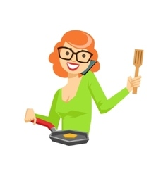 Housewife chatting on the smartphone while cooking vector