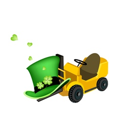 Yellow forklift truck loading four leaf clovers vector