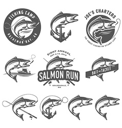 Vintage salmon fishing emblems and design elements vector image