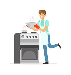 Young smiling man cooking in the kitchen house vector