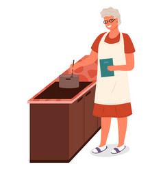 Senior lady cooking soup food in kitchen at home vector