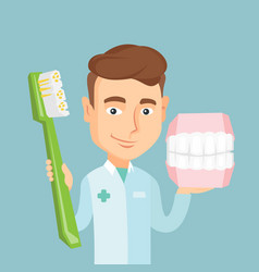 dentist with dental jaw model and toothbrush vector image