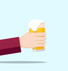 Left hand holding a beer glass and blue background vector