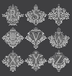 Set of heraldic monograms in coats of arms form vector