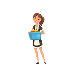 Smiling maid holding a basin with clean linen vector