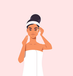 Young woman applying eye drop dressed in towel vector