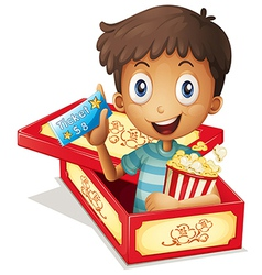 A boy inside the box holding a popcorn and a vector image