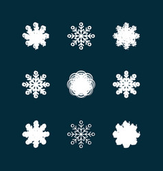 this is a set of grunge icons of snowflakes vector image