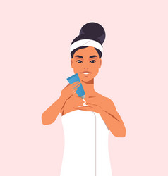 Young woman applying skin cream dressed in towel vector