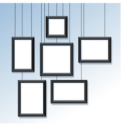 Blank pictures or photo frames on wall vector