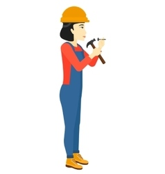 Woman hammering nail vector