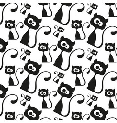 Seamless pattern black cats vector