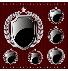 set of silver emblem with shield and wreaths vector image