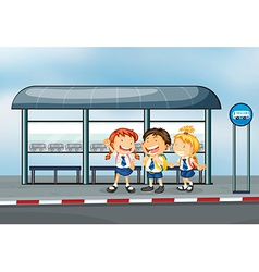 Students at the bus stop vector image vector image