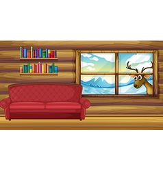 An empty sofa with bookshelves at back vector