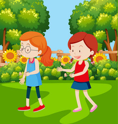 Girls having an egg and spoon race vector