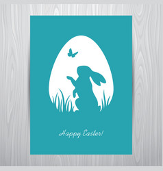 standing rabbit silhouette in an egg shaped frame vector image