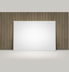blank white poster frame on floor with wooden wall vector image