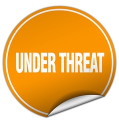 Under threat round orange sticker isolated on vector