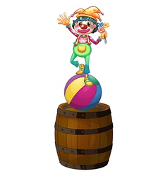 A playful clown above the wooden barrel vector image