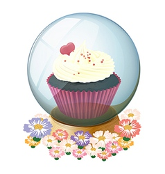 A crystal ball with a mouthwatering cupcake vector image vector image