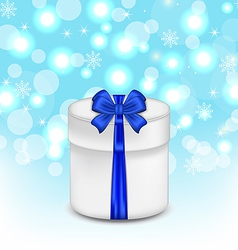 Gift box with blue bow on glowing background vector image vector image