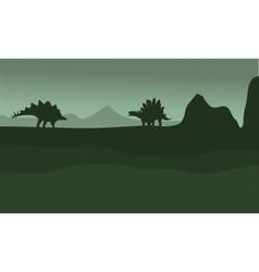 Stegosaurus in fields scenery silhouette vector