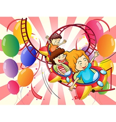 Kids enjoying the roller coaster ride vector
