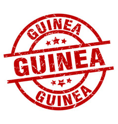 guinea red round grunge stamp vector image vector image