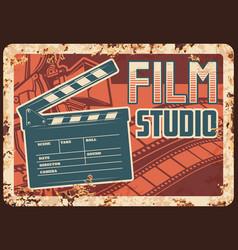 Film studio rusty metal plate with clapperboard vector