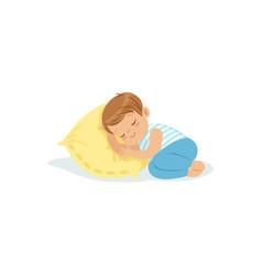 cute little boy sleeping on a pillow cartoon vector image