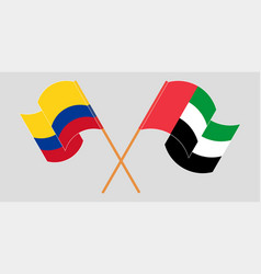 Crossed and waving flags colombia vector