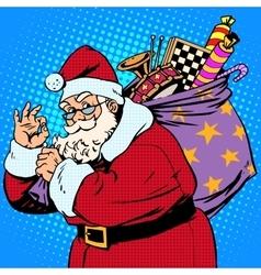 Santa Claus with gift bag okay gesture vector image vector image