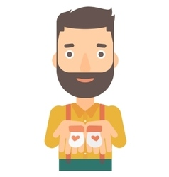 man holding baby booties vector image