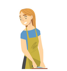 Young woman in apron cooking in kitchen girl vector