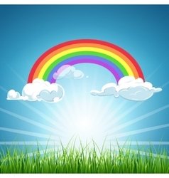 Rainbow clouds blue sky and grass vector