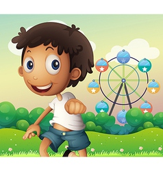 A boy standing across the ferris wheel vector