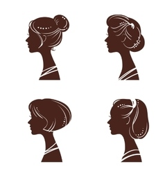 Four silhouettes of women vector image