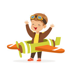 Cute little boy in pilot costume playing toy plane vector
