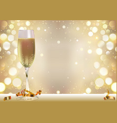 golden bokeh background with champagne glass vector image