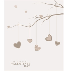 Hearts hanging on a tree branch vector