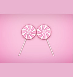 Two pink lolipops candy on pastel pink background vector