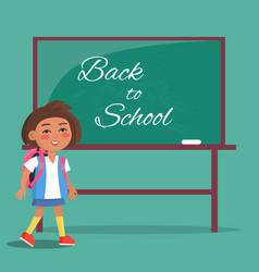 back to school written on green blackboard girl vector image