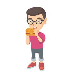 Little caucasian boy eating a hamburger vector