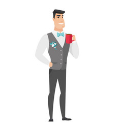 young caucasian groom holding cup of coffee vector image