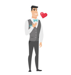 Caucasian groom holding hand on his chest vector