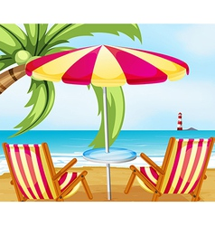 A chair and an umbrella at the beach vector image vector image